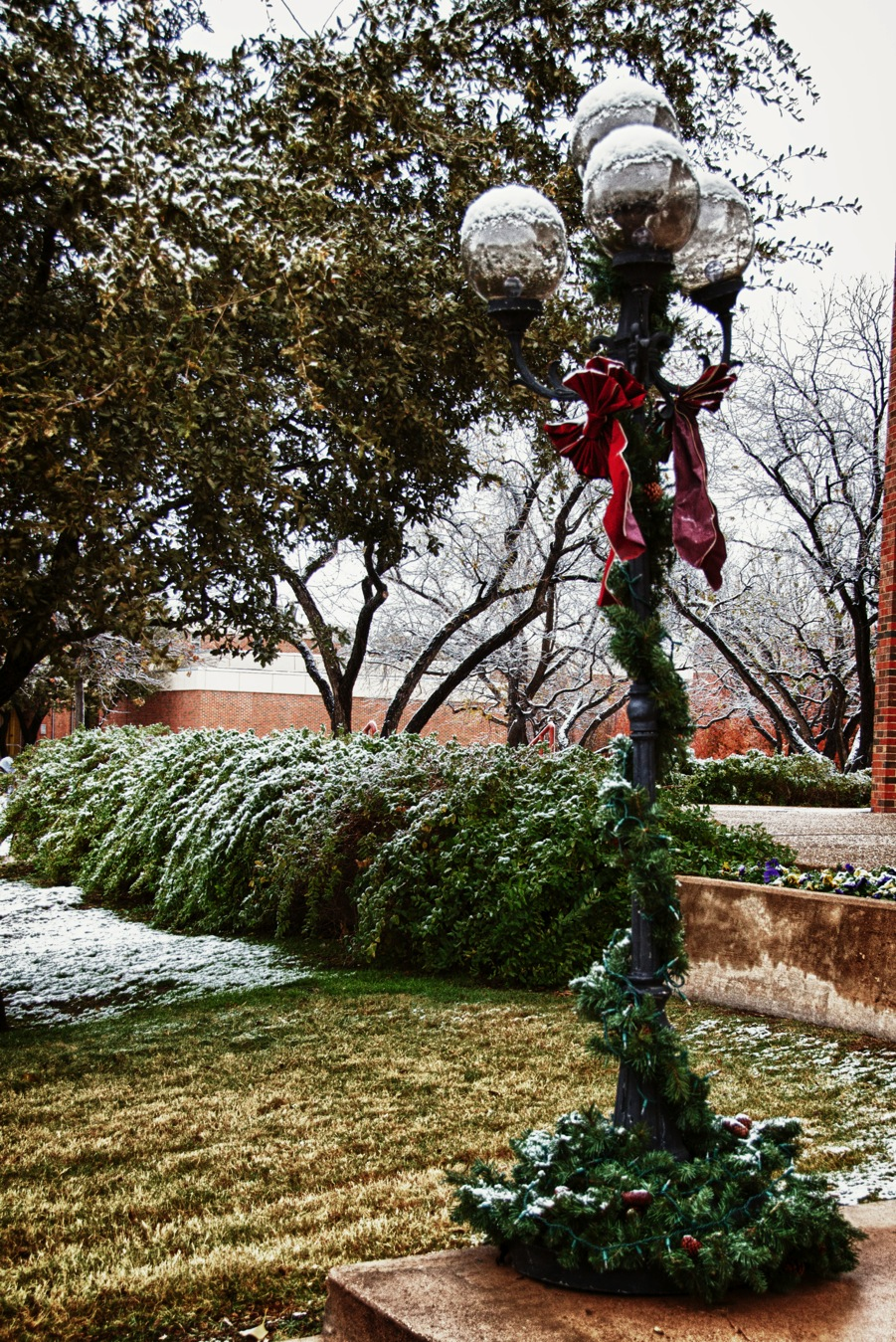 Three-bulb light standard and Christmas wreath
